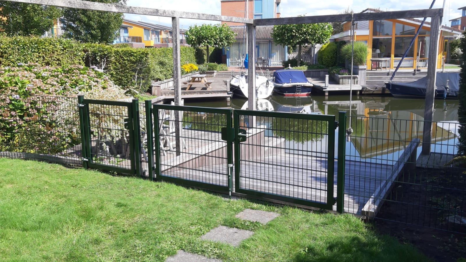 Draaipoort tuin aan het water | Bakker Hekwerk